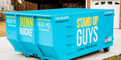 removing junk furniture with a dumpster