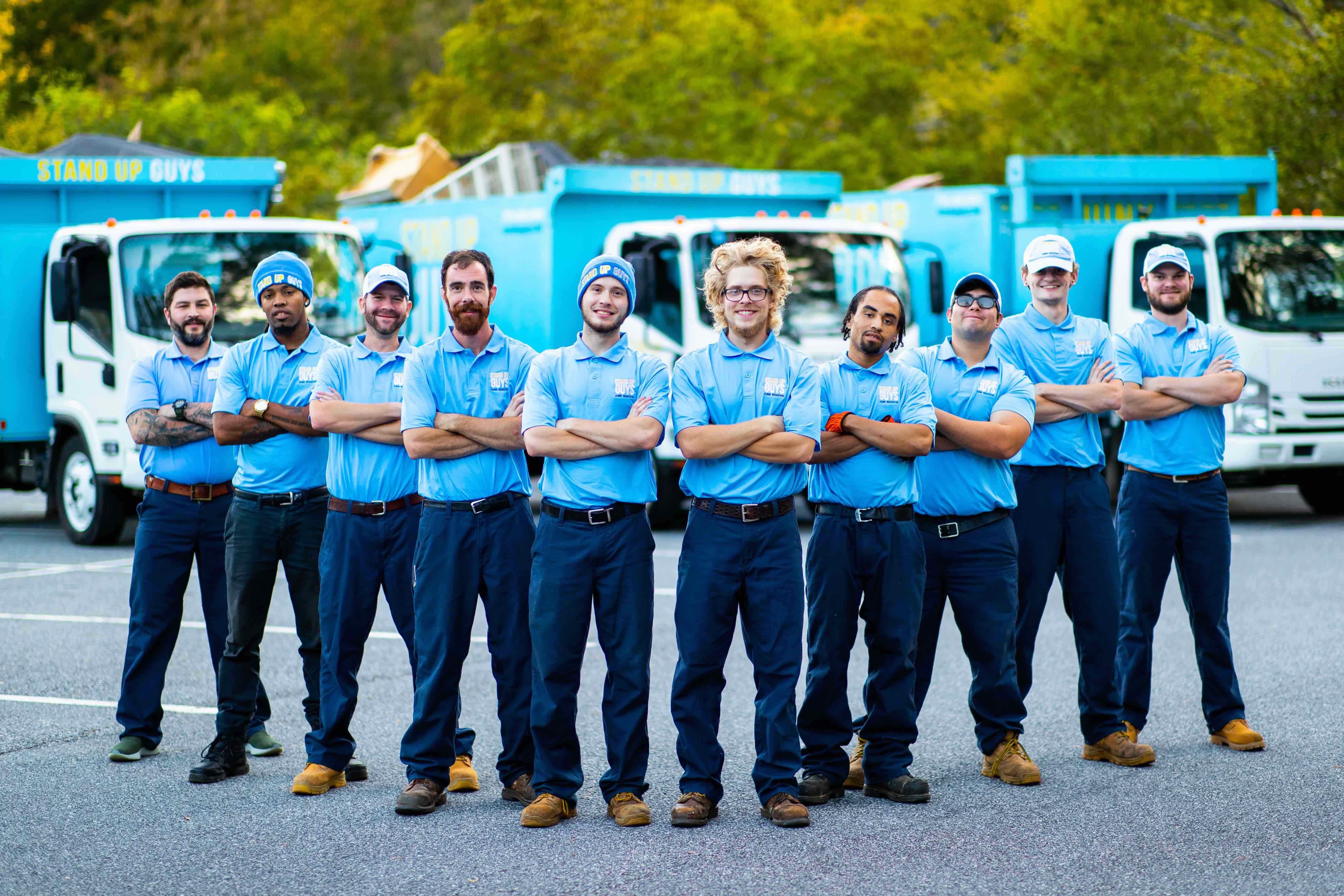 junk removal men in Belmont, NC standing in front of trucks