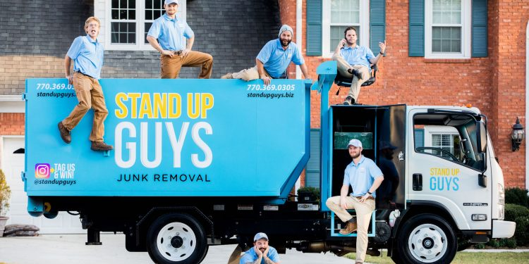 junk removal crew standing by truck in Mckinney texas