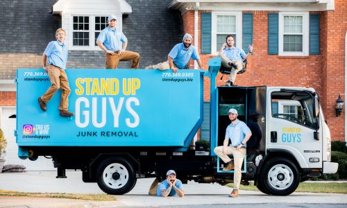 stand up guys standing in front of junk removal truck in frisco texas