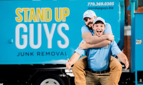 stand up guys junk removal crew in front of their junk truck in arlington texas