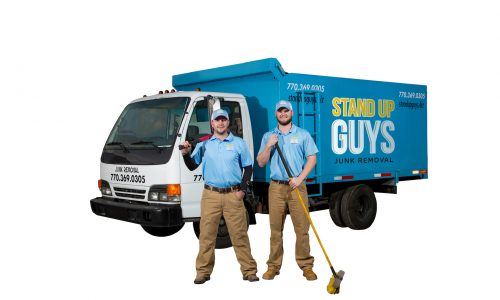 two men standing in front of a junk removal truck in addison texas