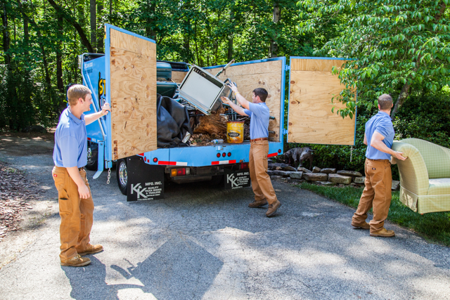 loading household junk into a truck