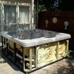junk hot tub outside house