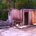 Small, wooden, junk shed