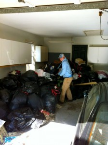 garage full of junk and trash in vinings