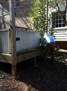 This is a junk hot tub in the back of a Marietta Home