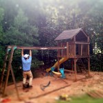 ross hanging from play set