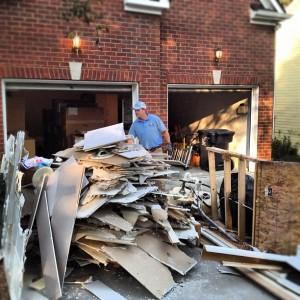 pile of construction debris on driveway