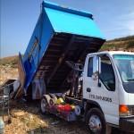 junk truck dumping construction debris