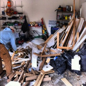 man cleaning up demo in garage